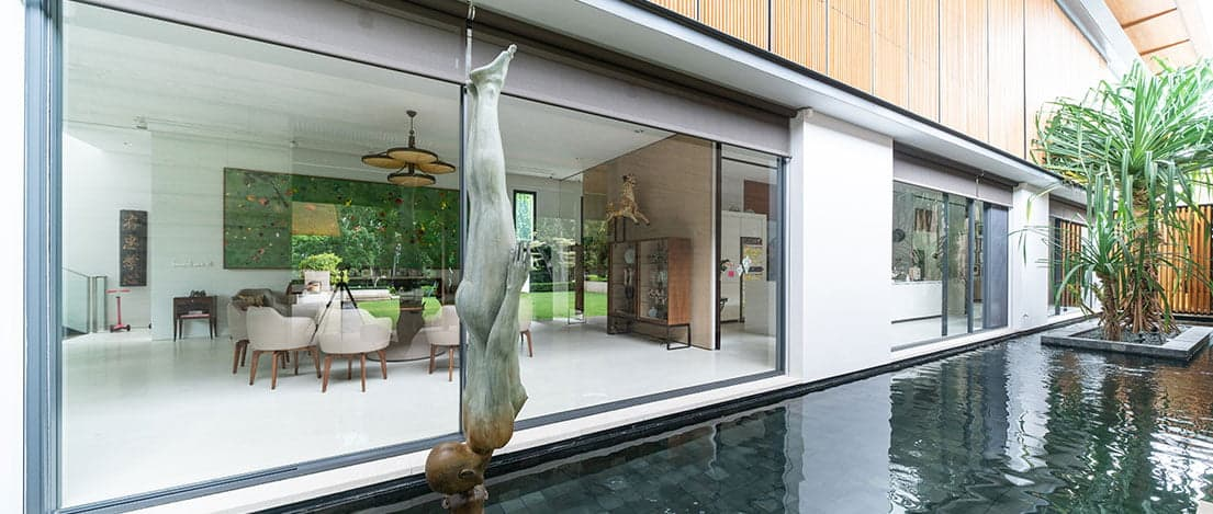 SKY-FRAME Sliding doors with inbuilt SKY-FRAME FLY insect screen at 46 Nassim Road by  Ernesto Bedmar Architects Pte Ltd